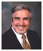 DR. PETER E. TARLOW